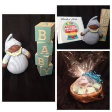 An example of a prepackaged gift basket. Includes BABY Blocks and Rattle Doll. Pink package also available. Cost: $32.00