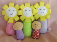 "The Happy Flower Toys are great for young babies. The vibrant colours and soft minky fabric help to stimulate babies, and they squeak when you give them a squeeze. Cost: $17.50. The Mini lolly dollies are perfect to tuck away in a pocket or purse and pull out as required. Price: $12.00 *The purple one has a matching purple ""Mommy"" counterpart"