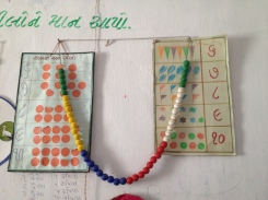 Beads (possibly used for counting) displayed beside number charts
