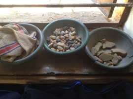 rocks by the windowsill, possibly used in counting
