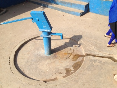 A hand pump located outside in the courtyard - ideal for washing feet