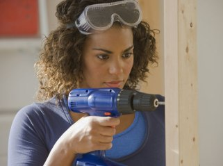 woman-using-cordless-drill-ht4w600