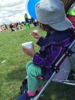 H enjoying her ice cream cup. The rest of us had kulfis.