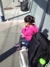 Excitedly waiting to take the train to downtown.